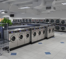 Interior view of Liberty Laundry Delaware Store self-service coin laundromat and drop-off laundry service, featuring beautiful tiled flooring, rows of stainless steel front loading Speed Queen high capacity washers and dryers.
