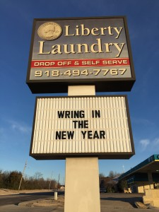 "A street sign at Liberty Laundry that says, ""Wring in the New Year."""